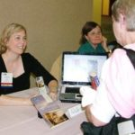 RuthAnn Hogue sells and signs books during NFPW Annual Conference in Seattle.